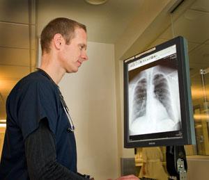 Nurse reviewing x-ray